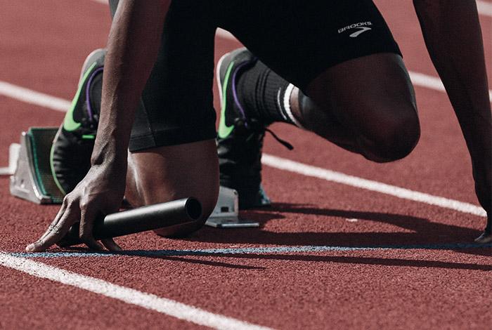 Sportpsychologe trainiert Laeufer